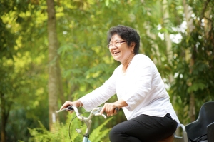 bigstock--s-senior-Asian-woman-riding